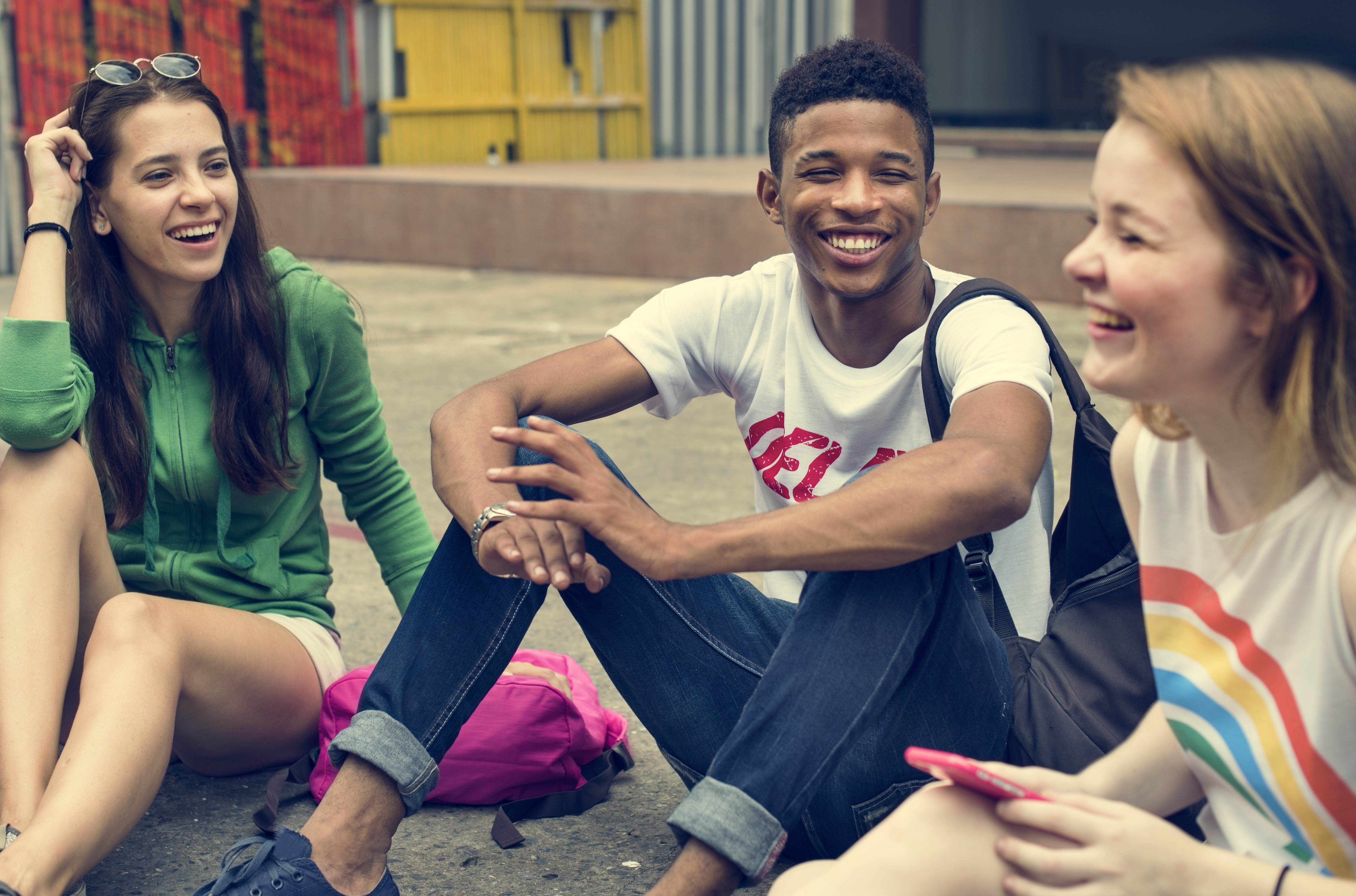 group of youth sitting on the ground